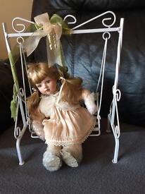 Doll on swing