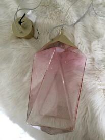 A pink glass pendant light