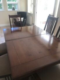Oak wood dining room table and 7 chairs with a Rosewood finish