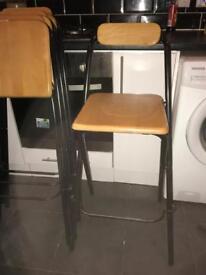 Four folding stools.