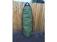6 FT SURFBOARD WITH BOARD BAG, LEASH, FINS AND TAIL PAD. OPEN TO OFFERS.