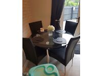 clear & black glass kitchen table with 4 leather chairs