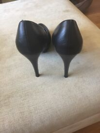 Nearly as new black high heels size 5
