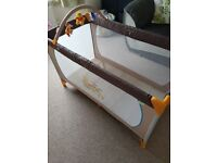 Winnie the Pooh travel cot - used handful of times. Excellent condition