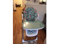 High chair with attached toy basket