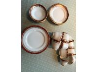 Bone China dinner service, duchess. Tea cups, saucers, side plates (11 of each) & main plates (17)