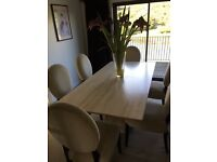 Marble dining table with chairs and matching sideboard