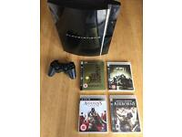 Playstation 3 with one controller and 4 games