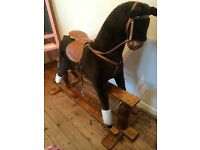 Sturdy old fashioned rocking horse. Not for babies. Holds up to 9 stone and still rocks.