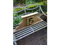 An Antique Carved Letter B on a Plinth