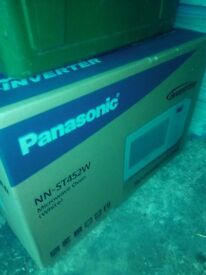 Panasonic microwave brand new, boxed, unopened. Model NN-ST452W, unwanted gift. Buyer collects