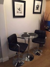 Chrome and glass bistro table with 2 chrome and black leather chairs