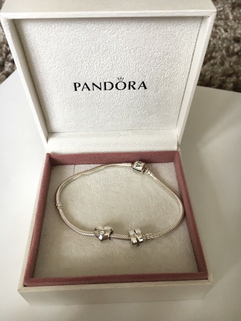 Original pandora bracelet with two charms included