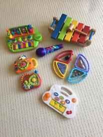 Selection of musical interactive toys.