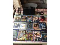 PlayStation two with games