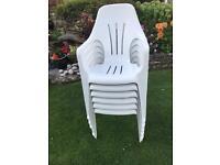 Six plastic stacker chairs