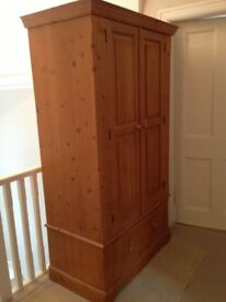 Large wooden wardrobe with single drawer