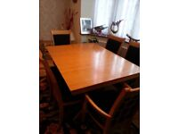 Wooden Extending Dinning table and 6 chairs