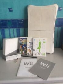 Wii Console + wii fit + package