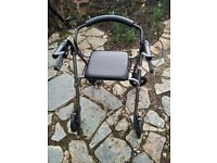 Rollater walking aid