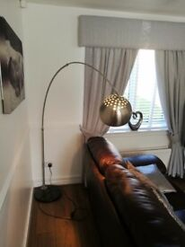 Large stainless steel floor lamp never been used
