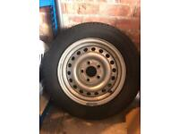 Wheel and new tyre