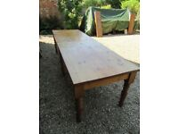 A PAIR OF IDENTICAL PINE TABLES ( 9 ft long together ). Delivery possible. ALSO CHURCH PEWS & SETTLE