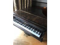 Very old ( but still playing ) baby grand piano