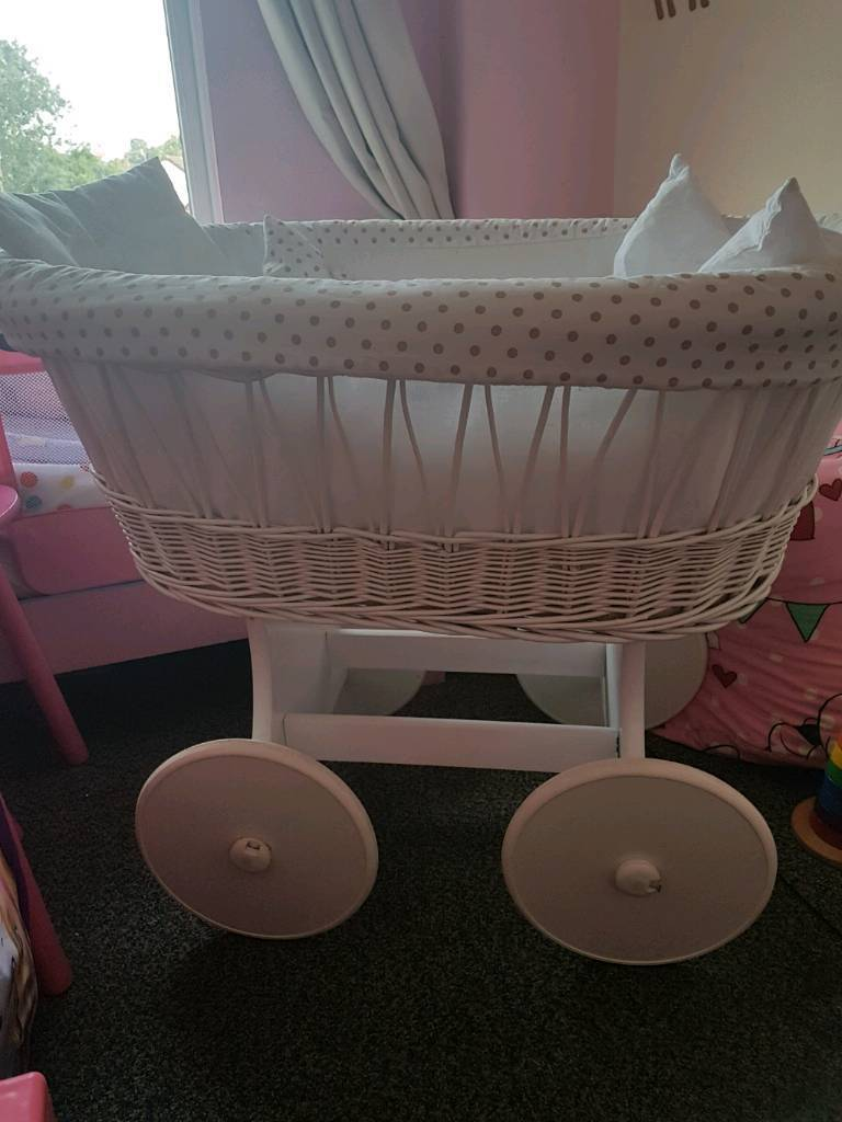 Baby wicker crib on wheels