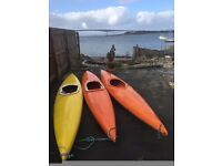 3 old style Kayaks