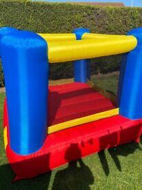 Kids multi coloured bouncy castle