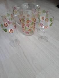 6 plastic wine glasses and jug