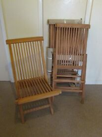 Four new wooden folding garden chairs excellent quality £60 ono