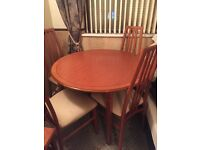 extendable round wooden dining table
