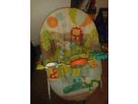 Bright starts safari baby bouncer with toy bar