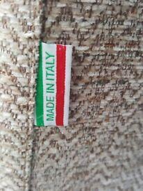 Beautiful 2 + seater sofa. Italian made, fabric and leather