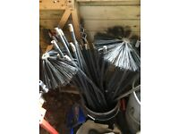 Five sets of drain rods and two chimney brushes