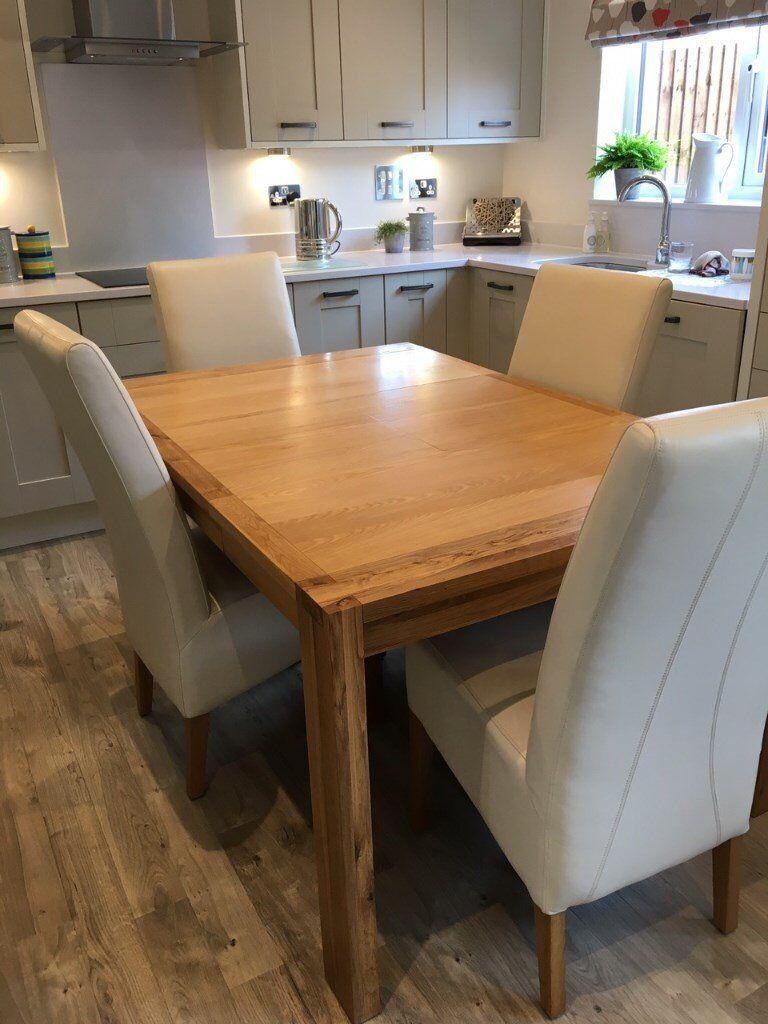 john lewis solid oak extending dining table and 4 cream. Black Bedroom Furniture Sets. Home Design Ideas