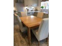 John Lewis Solid Oak extending dining table and 4 cream leather chairs