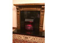 Lovely Oak fireplace with electric fire on granite base rrp £850 Excellent condition