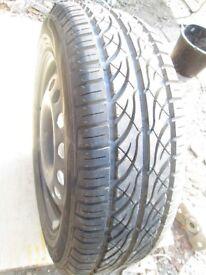 Unused spare wheel & tyre Ford rim 195 x 15---5 stud