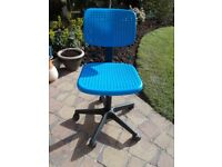 A SMALLER STYLE SWIVEL COMPUTER CHAIR, WITH HEIGHT ADJUSTMENT AND BLUE PLASTIC EASY CLEAN SEAT