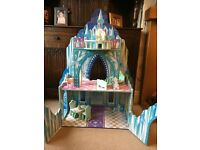 wooden ice castle with accessories and figures. (Teamson Kids Ice Mansion Doll House)