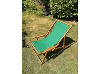 hard wood deck chairs with arms and dark green canvas