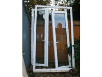 UPVC white double glazed patio doors. 3 years old
