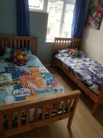 2 solid wood bed frames. Excellent condition. Smoke free home. Bed frames are 1 year old.