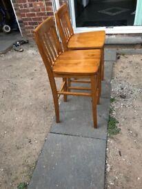 Tall wooden bar stools