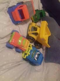 Large trucks and digger