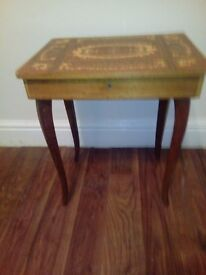 Small serreto musical table, marquetry top, still plays music, no key and slight chip on one corner