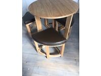 Beech Wood round table and 4 stools with brown leather seat pad